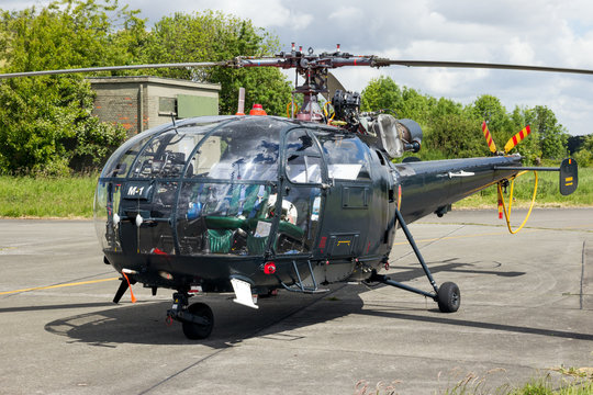 BEAUVECHAIN, BELGIUM - MAY 20, 2015: Belgian Navy Aerospatiale Alouette III rescue helicopter sitting idle on Beavechain airbase.