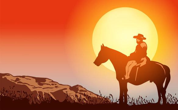 Cowboy on horse ride on sunset. Mountains on the horizon