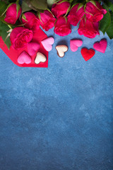 Blue background for congratulations on Valentine's Day with red roses, envelope and hearts.