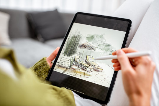 Artist or designer making landscape design, drawing on a digital tablet with pencil, close-up on a screen. Designing on a digital touchpad concept