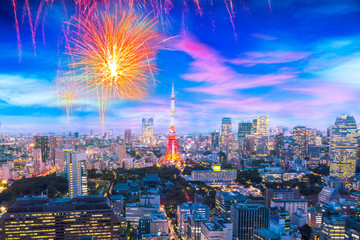 Foto auf Leinwand Flieder Cityscape of Tokyo, city with firework display for celebration, aerial skyscraper view of office building and downtown and street of minato in tokyo with sunset / sun rise background. Japan, Asia