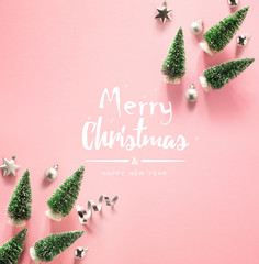 Art Merry Christmas and Happy Holidays greeting card, frame, banner. New Year. Noel. Christmas ornaments light pink background. Winter xmas holiday theme. Flat lay