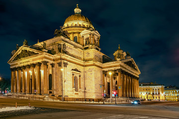 facade of St. Isaac's Cathedral in the rays of light against the night sky in St. Petersburg, Russia
