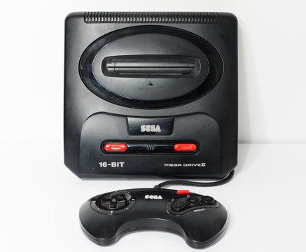 london, england, 05/05/2018 Sega megadrive 2 16 bit and Sega Mega drive 2 black shiny plastic retro arcade vintage gaming. Retro arcade gaming history. home entertainment.
