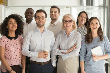 Smiling diverse employees posing for photo in office Fotobehang
