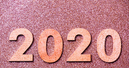 Glitter textured pink party web banner, background of 2020 numbers, happy new year with copy space