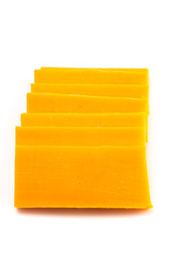 Rectangle Slices of Sharp Cheddar Cheese on a White Background