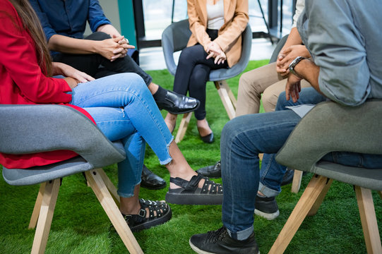 Psychotherapist inquiring about symptoms occurring within mind from patients with mental health problems in hospital. Group psychotherapy support and helping drug addition to change negative mindset