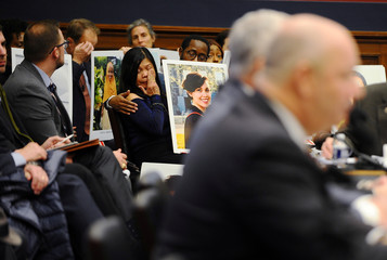 Clariss Moore wipes a tear while Federal Aviation Administration (FAA) Administrator Stephen Dickson testifies before a House Transportation and Infrastructure Committee hearing at the Rayburn House office building in Washington
