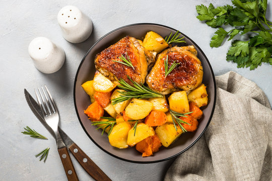 Baked chicken with vegetables top view.