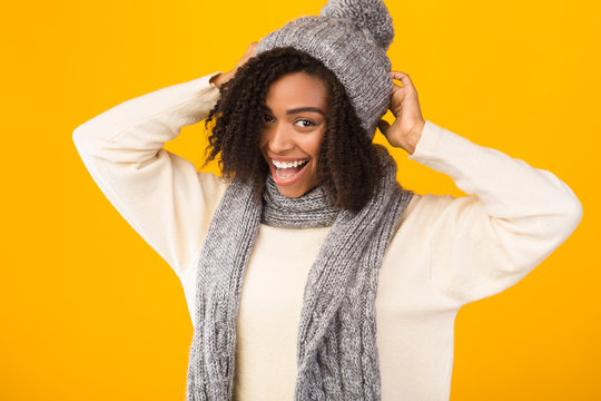 Cheerful african american girl wearing hat and scarf