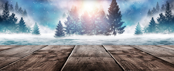 Foto op Plexiglas Cappuccino Winter background. Winter snow landscape with wooden table in front. Dark winter forest background at night. Snow, fog, moonlight. Dark neon night background in the forest with moonlight.