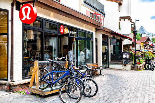 Vail, USA - June 29, 2019: Vacation ski resort town village in Colorado with Lululemon shop store on Gore Creek drive