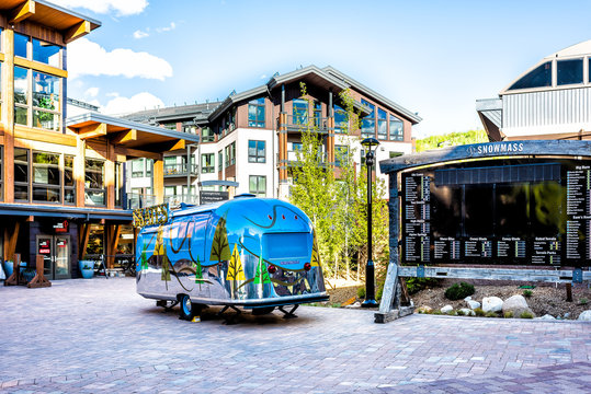 Aspen, USA - June 24, 2019: Snowmass village town square in base town in Colorado downtown with nobody and airstream truck by sign