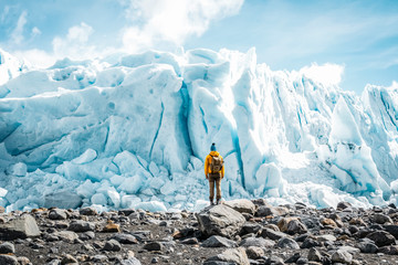 Backpacker doing a trekking on the Perito Moreno Glacier