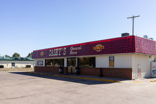 Larned, USA - October 14, 2019: Small town in Kansas with exterior of building for Casey's General Store and sign