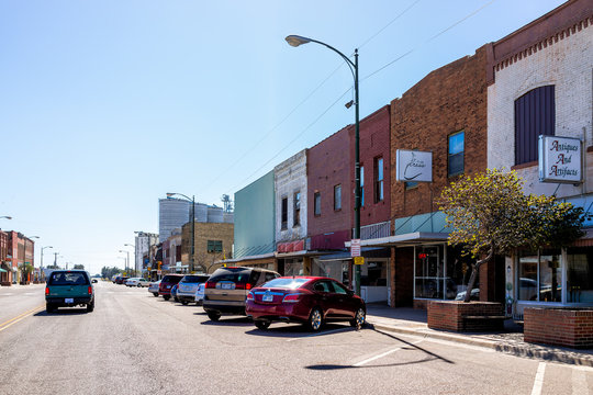 Larned, USA - October 14, 2019: Small city in Kansas with downtown main street historic architecture buildings stores shops