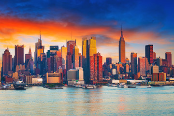 Wall Mural - Manhattan skyline illuminated by sunset