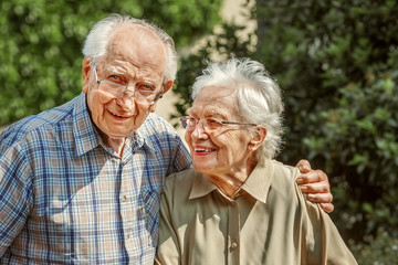 Elderly Couple Standing Together Outside