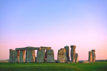 Stonehenge at pastel colourful sunset sky. Stonehenge, ancient prehistoric stone monument near Salisbury, Wiltshire, UK. UNESCO World Heritage.