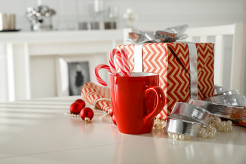 Wall Mural - Red mug on white wooden table and free space for your decoration.