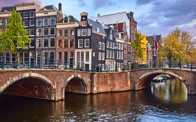 Fototapete - Bridge over channel in Amsterdam Netherlands houses river Amstel landmark old european city spring landscape.