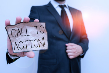 Conceptual hand writing showing Call To Action. Concept meaning exhortation do something in order achieve aim with problem Male human wear formal work suit with office look hold book