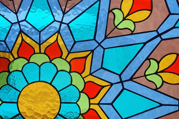 Stained glass floral geometric pattern.