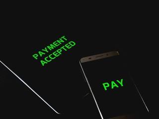 Contactless payment between smartphone and tablet pay cashless - payment accepted