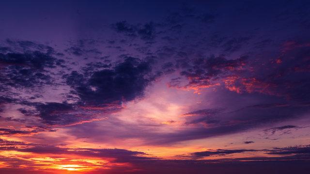 Dramatic cloudscape at sunrise over ocean