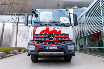 MUNICH / GERMANY - APRIL 14, 2019: Mercedes Benz truck with a concrete pump stands in front of a hall in Munich.