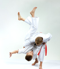 Sportsmens in performing throws judogi
