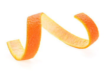 Orange peel in shape of spiral isolated on a white background. Beauty health skin concept.