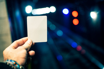 Hand Holding Blank Card In Cool Urban Metro Setting Message Communication Concept