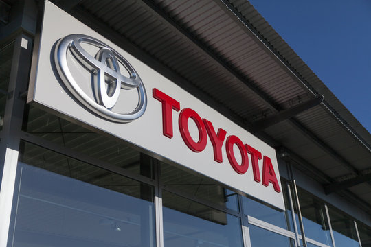 FUERTH / GERMANY - FEBRUARY 25, 2018: Toyota logo near a car dealer building. Toyota Motor Corporation is a Japanese multinational automotive manufacturer headquartered in Toyota, Aichi, Japan.