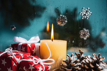 Candle burning in festive Christmas environment