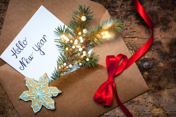 Happy New Year card in a decorated envelope