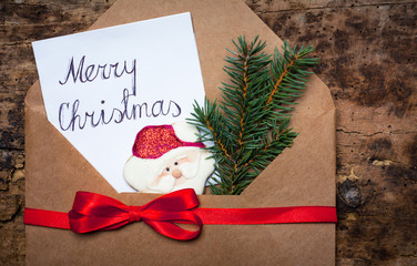 Merry Christmas card in a decorated envelope