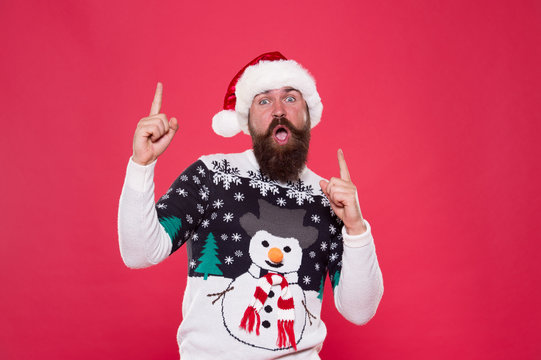 Best time. excited hipster funny sweater with snowman. winter holiday celebration. feeling freedom and success. new year happiness. merry christmas to you. having fun. happy bearded man red santa hat