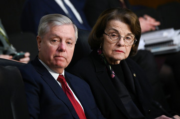 Sen. Graham and Sen. Feinstein listen as U.S. Justice Department Inspector General Horowitz (not pictured)  testifies before a Senate Judiciary Committee hearing in Washington