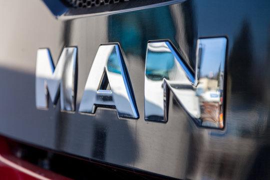 NUERNBERG / GERMANY - MARCH 4, 2018: MAN logo on MAN TGS 35.460 8X8 dumper truck near factory in Nuernberg.