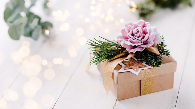 Beautiful, feminine and romantic christmas gift box with bright light background and pastel colors / banner, header