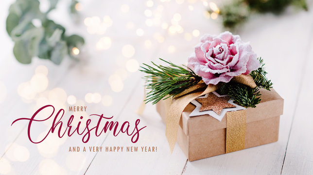 Beautiful, feminine and romantic christmas gift box with bright light background and pastel colors / banner, header and elegant greeting text