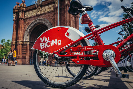 Barcelona, Spain - May 23, 2015. Viu Bicing share system next to triumphal arch at Lluis Companys Promenade in Barcelona