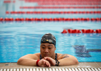 Singapore Paralympian Theresa Goh takes a break from a swim at the OCBC Aquatic Centre