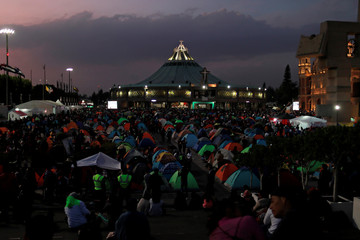 Pilgrims camp at the Basilica of Guadalupe during the annual pilgrimage in honor of the Virgin of Guadalupe, patron saint of Mexican Catholics, in Mexico City