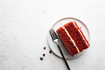 Top view of slice of red velvet cake with copy space on white background.