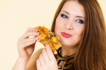 Woman eating hot pizza slice