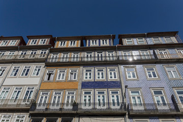 outer wall of the house in Lisbon decorated with ceramic tiles with a beautiful geometric pattern