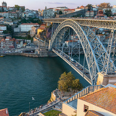 view from the hill to the Douro River and the beautiful Ponte Luis I Iron Bridge in the Portuguese city of Porto